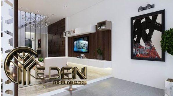 Thiết kế kệ gỗ cho tivi treo tường và tranh trên nền tường trắng để tạo điểm nhấn cho không gian