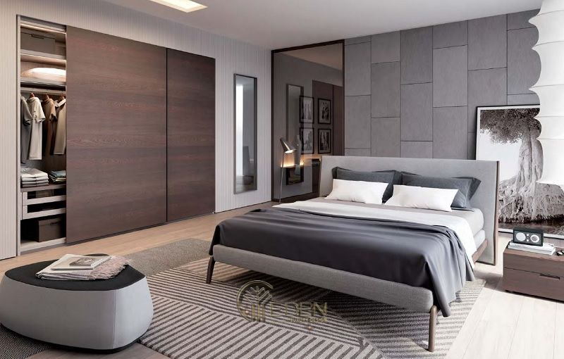 Mẫu thiết kế phòng ngủ lớn mang phong cách tối giản hiện đại dành cho các căn biệt thự. Gam màu nâu nhạt kết hợp với màu gỗ tự nhiên khiến cho tổng thể trở nên hài hòa. ấm áp hơn