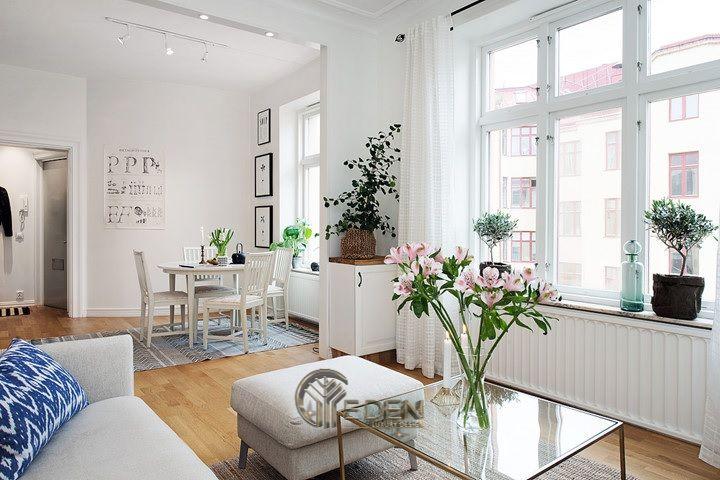 Mẫu bàn ăn tối giản với gam màu trắng nhẹ nhàng cho căn hộ chung cư mini