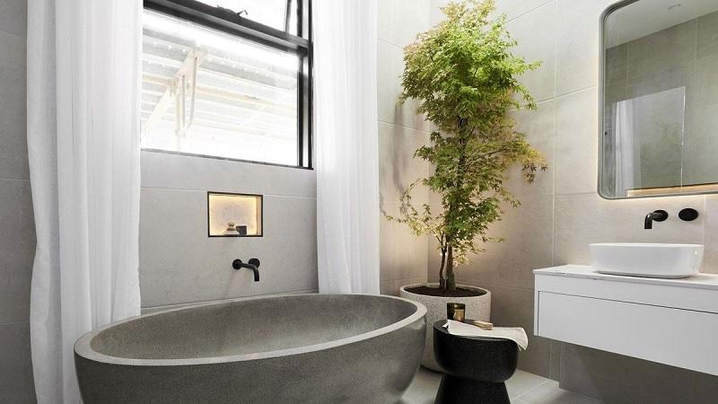 """Phong cách phòng tắm """"xanh"""" thường khá đơn giản. Đó là việc bạn có thể sắm một vài cây xanh trong phòng tắm để tạo cảm giác trong lành cho không gian."""