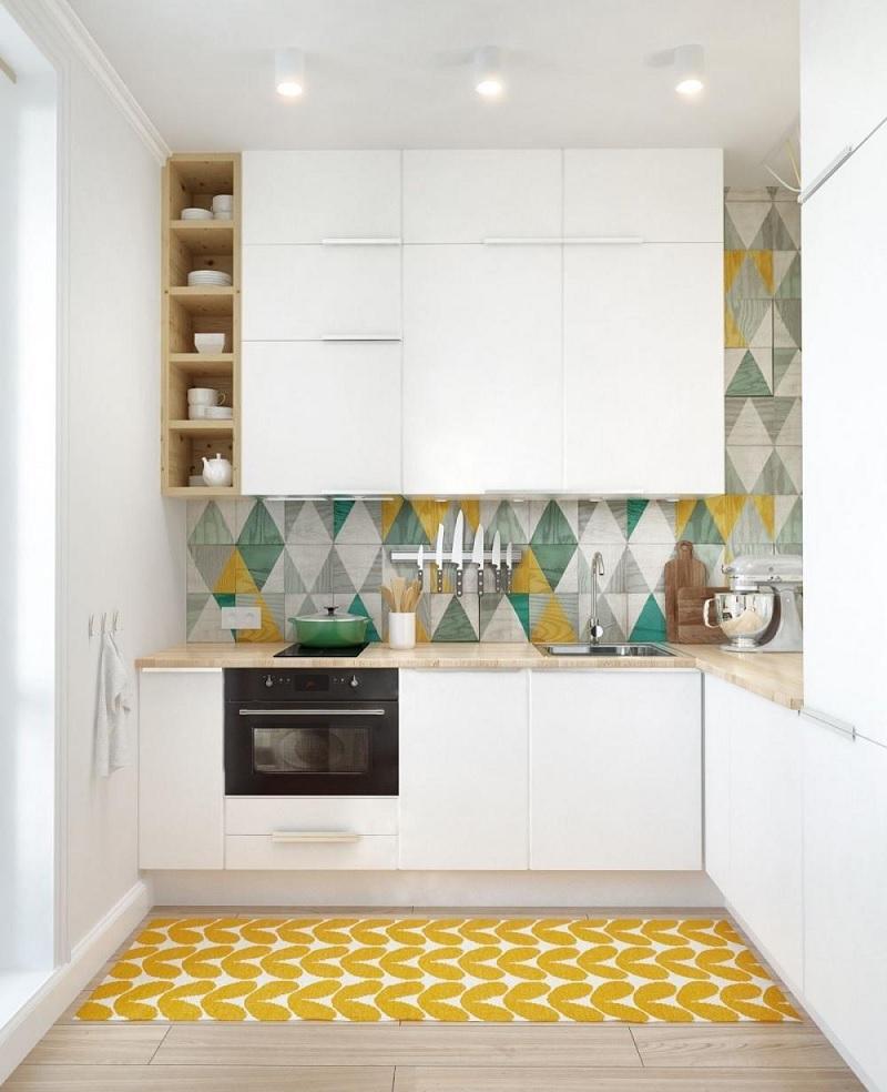 Trang trí nhà bếp với thảm có họa tiết xương cá giúp cho không gian trở nên rộng hơn. Đồng thời tạo điểm nhấn với thảm màu sắc giúp không gian trở nên rực rỡ, khác biệt