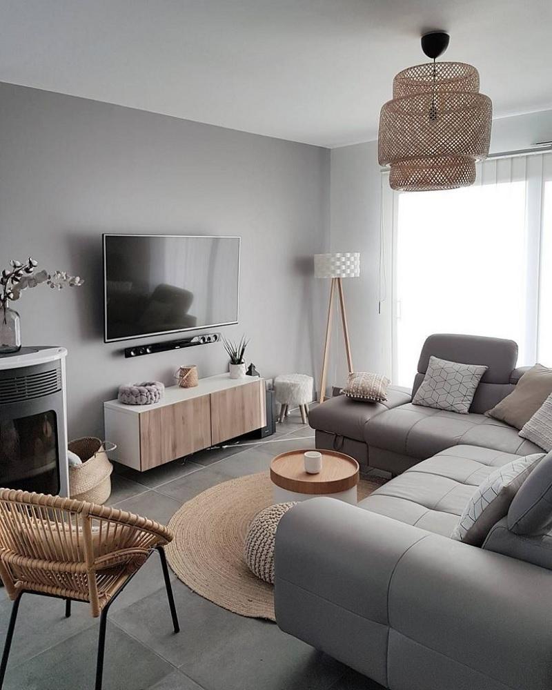 Mẫu phòng khách giản dị, mộc mạc với nội thất có đường nét mềm mại.