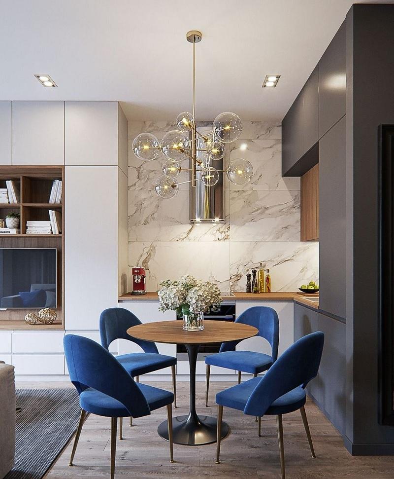 Mẫu thiết kế phòng ăn đẹp với mẫu bàn tròn đơn giản, mảnh mai. Mẫu thiết kế này phù hợp với những gia đình ưa thích sự tinh tế, tinh xảo từ màu sắc đến nội thất không gian