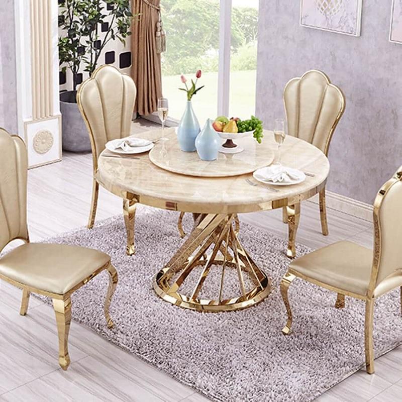 Mẫu bàn ăn tròn kết hợp mâm xoay thông minh sẽ phù hợp với một đại gia đình đông đúc.