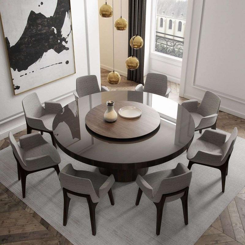 Mẫu thiết kế phòng ăn đẹp với mẫu bàn tròn gỗ tạo cảm giác mạnh mẽ, tinh tế và quyền lực